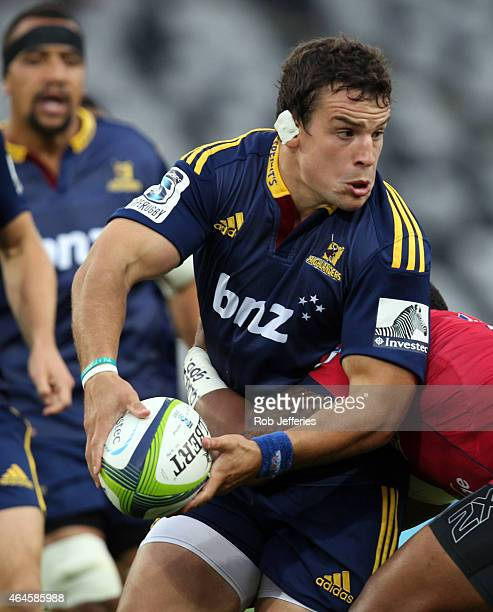 John Hardie of the Highlanders looks to pass during the round three Super Rugby match between the Highlanders and the Reds at Forsyth Barr Stadium on...
