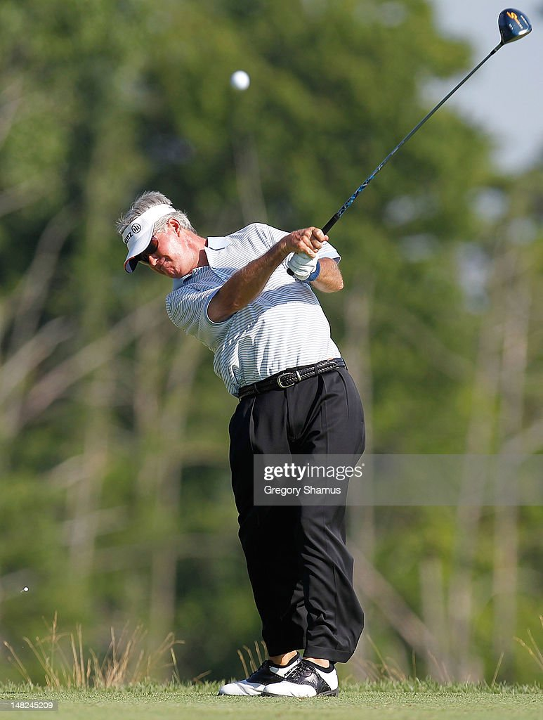 <a gi-track='captionPersonalityLinkClicked' href=/galleries/search?phrase=John+Harris+-+Golfer&family=editorial&specificpeople=649734 ng-click='$event.stopPropagation()'>John Harris</a> hits his tee shot on the ninth hole during the first round of the 2012 Senior United States Open at Indianwood Golf and Country Club on July 12, 2012 in Lake Orion, Michigan.