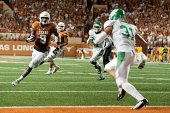 John Harris of the Texas Longhorns scores a 8 yard touchdown on a pass from David Ash against the North Texas Mean Green during the third quarter on...
