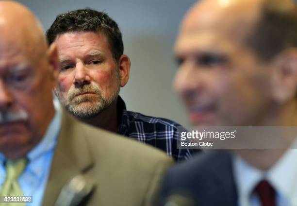 John Harris one of Paul R Shanley's alleged victims listens to attorneys Carmen L Durso and Mitchell Garabedian during a press conference at the Law...