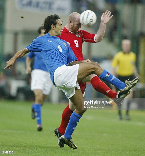 John Hartson of Wales battles with Alessandro Nesta of ltaly during the Euro 2004 Qualifier Group 9 match between Italy and Wales at the San Siro on...