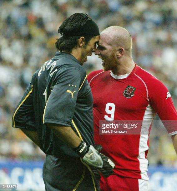 John Hartson of Wales goes head to head with Gianluigi Buffon of Italy during the Euro 2004 Qualifier Group 9 match between Italy and Wales at the...