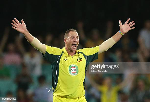 John Hastings of Australia celebrates taking the wicket of Rohit Sharma of India during game five of the Commonwealth Bank One Day Series match...