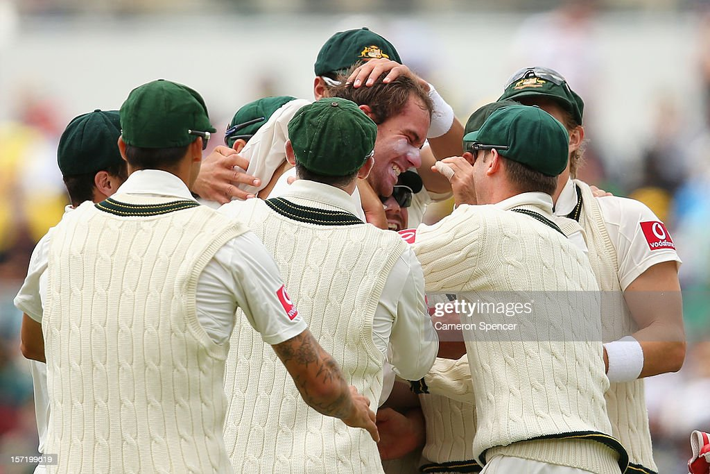 John Hastings of Australia celebrates with team mates after dismissing AB de Villiers of South Africa during day one of the Third Test Match between Australia and South Africa at the WACA on November 30, 2012 in Perth, Australia.