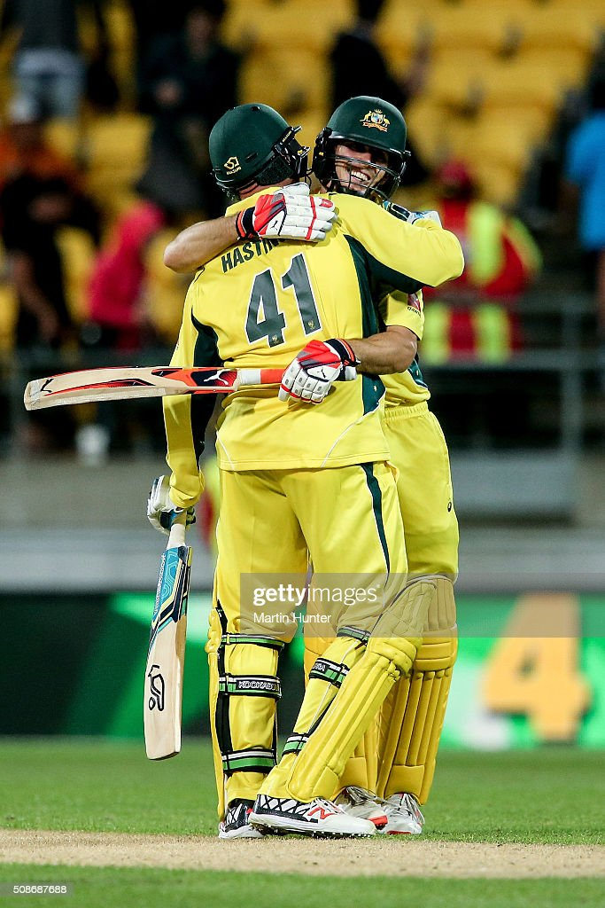 John Hastings of Australia hugs team mate Mitchell Marsh after game two of the one day international series between New Zealand and Australia at Westpac Stadium on February 6, 2016 in Wellington, New Zealand.