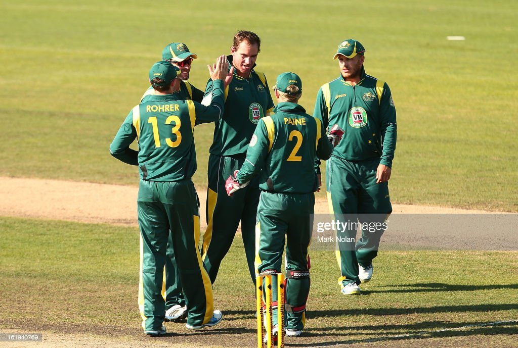 John Hastings of Australia is congratulated after getting a wicket during the international tour match between Australia 'A' and England at Blundstone Arena on February 18, 2013 in Hobart, Australia.