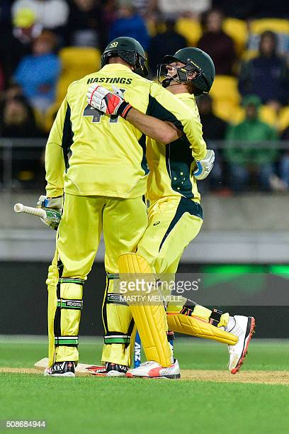 John Hastings of Australia picks up teammate Mitchell Marsh after hitting him with a shot during the second oneday international cricket match...
