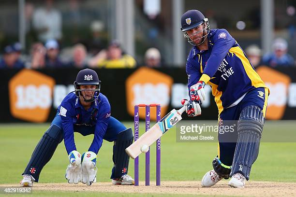 John Hastings of Durham hits out off the bowling of David Payne as wicketkeeper Gareth Roderick looks on during the Royal London One Day Cup Group A...