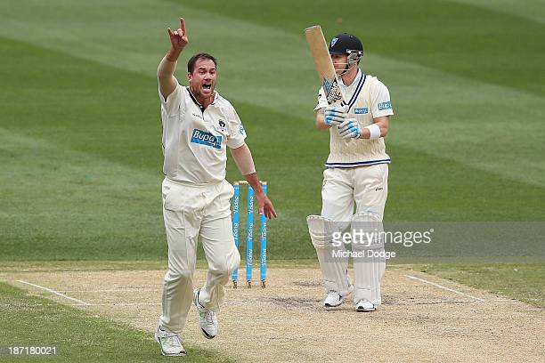 John Hastings of the Bushrangers appeals successfully for LBW against Michael Clarke of the Blues during day two of the Sheffield Shield match...