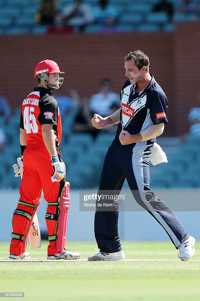 John Hastings (R) of the Bushrangers celebrates after getting the wicket of Dan Christian (L) of the Redbacks during the Ryobi One Cup Day match between the South Australian Redbacks and the Victorian Bushrangers at Adelaide Oval on February 9, 2013 in Adelaide, Australia.