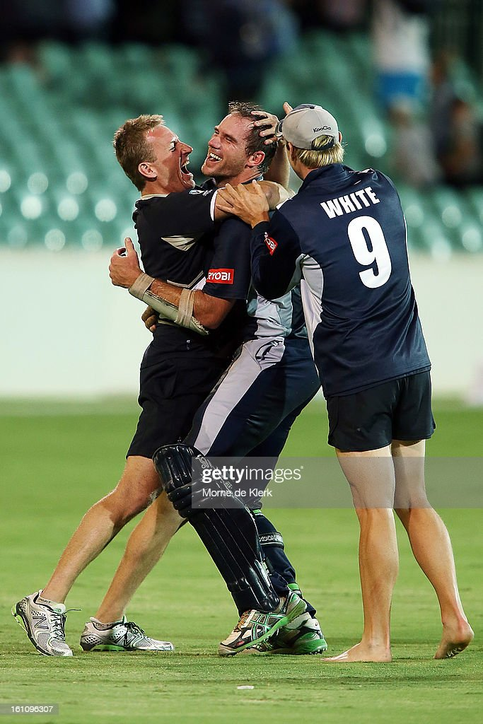 John Hastings (C) of the Bushrangers is congratulated after the Ryobi One Cup Day match between the South Australian Redbacks and the Victorian Bushrangers at Adelaide Oval on February 9, 2013 in Adelaide, Australia.