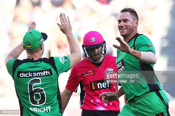 John Hastings of the Stars celebrates his wicket of Riki Wessels of the Sixers with Luke Wright during the Big Bash League match between the...