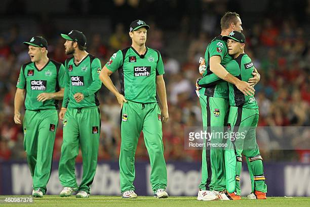 John Hastings of the Stars celebrates with teammates after taking the wicket of Dwayne Bravo of the Renegades during the Big Bash League match...