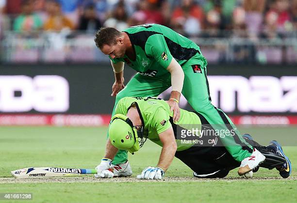 John Hastings of the Stars climbs over Aiden Blizzard of the Thunder to get the ball during the Big Bash League match between the Sydney Thunder and...