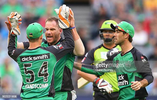 John Hastings of the Stars is congratulated by team mates after taking the wicket of Jacques Kallis of the Thunder during the Big Bash League match...