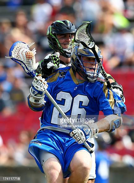 John Haus of the Charlotte Hounds is hit by Max Seibald of the New York Lizards at American Legion Memorial Stadium on July 20 2013 in Charlotte...