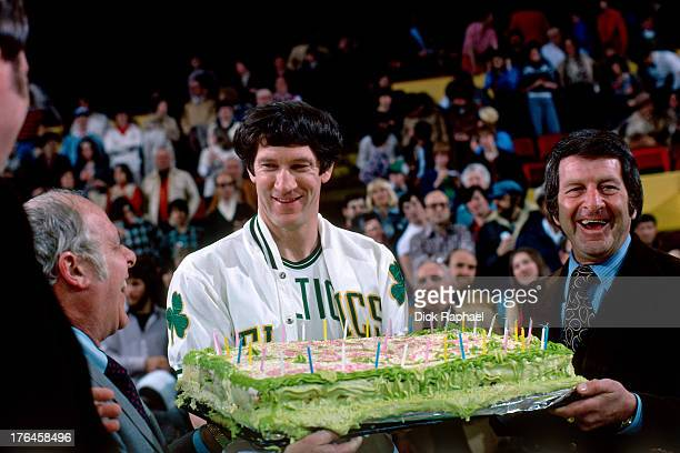 John Havlicek of the Boston Celtics celebrates with a cake during a game played circa 1977 at the Boston Garden in Boston Massachusetts NOTE TO USER...