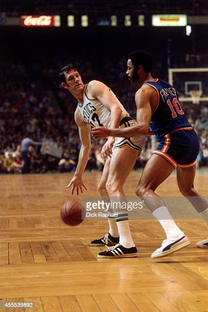 John Havlicek of the Boston Celtics dribbles the ball against Walt Frazier of the New York Knicks during a game circa 1970 at the Boston Garden in...