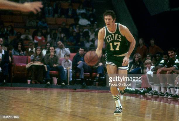 John Havlicek of the Boston Celtics dribbles the ball up court against the Capital Bullets circa 1973 during an NBA basketball game at the Capital...