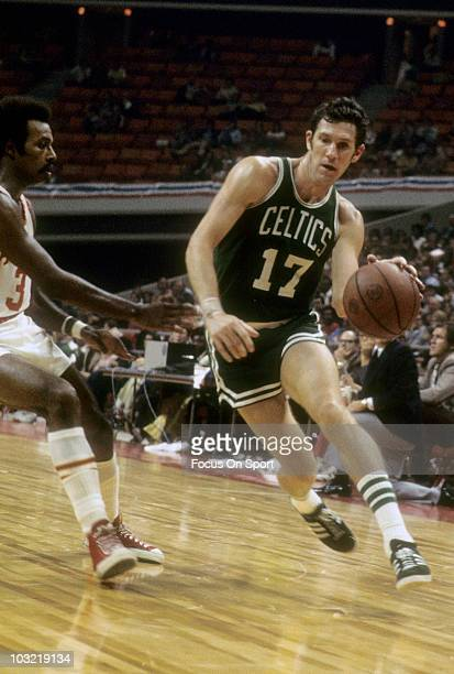 John Havlicek of the Boston Celtics dribbling the ball is guarded by Herm Gilliam of the Atlanta Hawks circa 1972 during an NBA basketball game at...