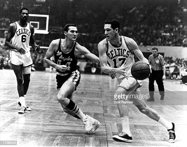 John Havlicek of the Boston Celtics drives past Jerry West of the Los Angeles Lakers during the 1970 NBA game at the Boston Garden in Boston...