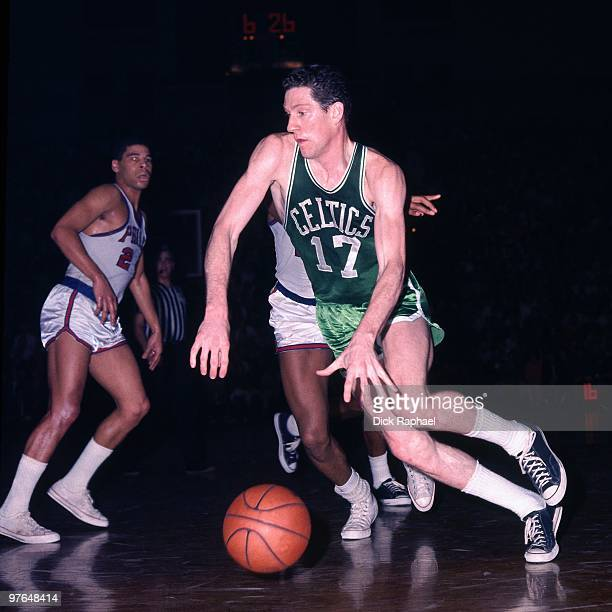 John Havlicek of the Boston Celtics drives the ball against the Philadelphia 76ers during a game played in 1967 at the Boston Garden in Boston...