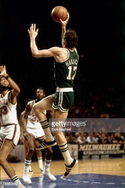 John Havlicek of the Boston Celtics drives to the basket against Kareem AbdulJabbar of the Milwaukee Bucks during an NBA game circa 19691975 at the...
