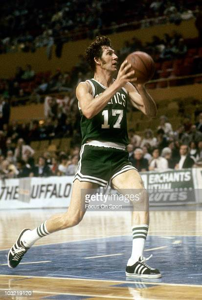 John Havlicek of the Boston Celtics drives to the basket against the Buffalo Braves circa 1975 during an NBA basketball game at the Buffalo Memorial...