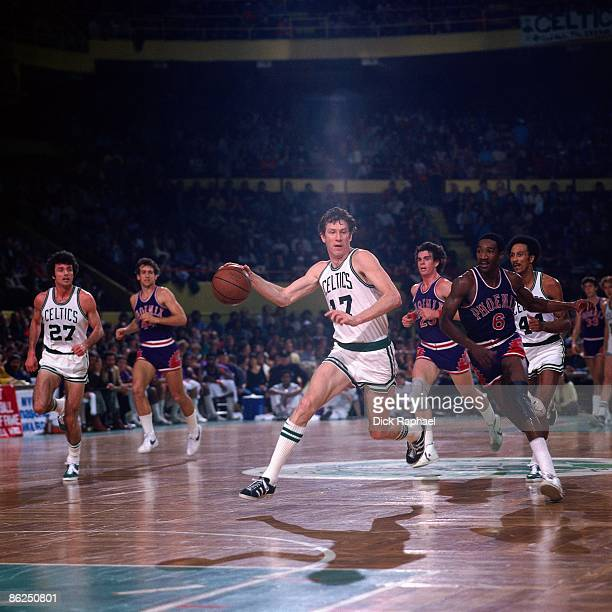 John Havlicek of the Boston Celtics drives up court against the Phoenix Suns during a game in the 1976 NBA Finals played at the Boston Garden in...