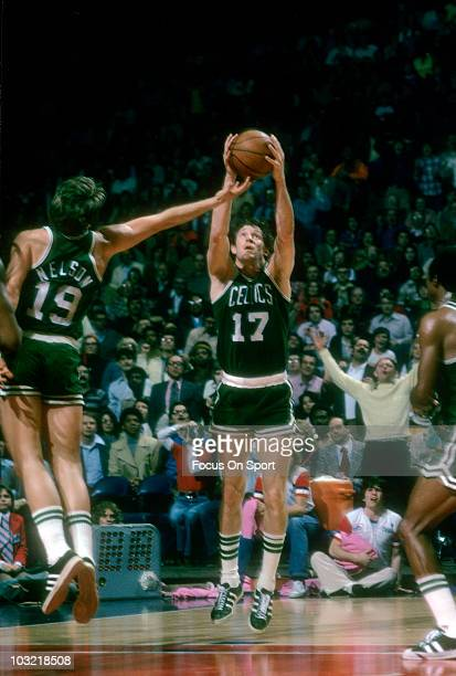 John Havlicek of the Boston Celtics grabs the rebound against the Capital Bullets circa 1973 during an NBA basketball game at the Capital Centre in...