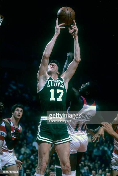 John Havlicek of the Boston Celtics grabs the rebound over Bob Dandridge of the Washington Bullets circa 1977 during an NBA basketball game at the...