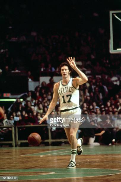 John Havlicek of the Boston Celtics moves the ball up court during a game played in 1975 at the Boston Garden in Boston Massachusetts NOTE TO USER...