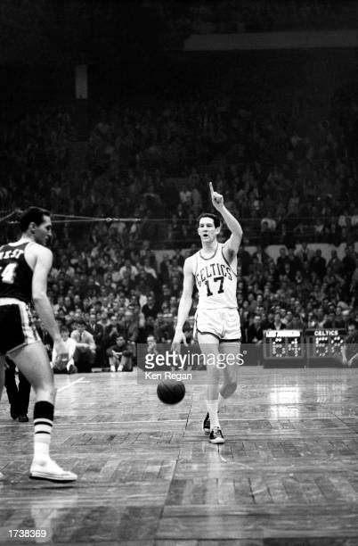 John Havlicek of the Boston Celtics moves the ball upcourt against the Los Angeles Lakers during the NBA game at Boston Garden on January 1 1966 in...