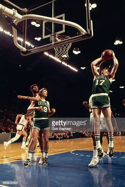 John Havlicek of the Boston Celtics rebounds against the Milwaukee Bucks during a game played in 1974 at the Mecca Arena in Milwaukee Wisconsin NOTE...