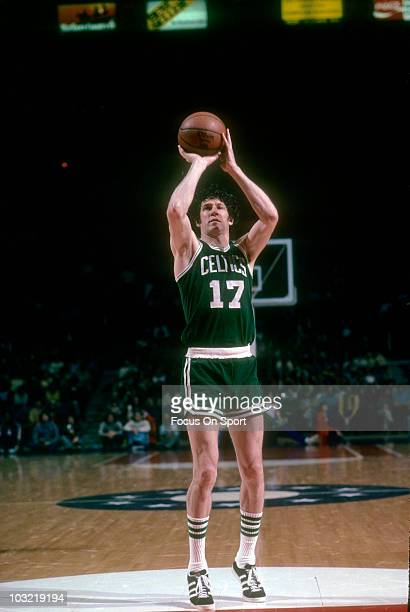 John Havlicek of the Boston Celtics shooting a freethrow against the Washington Bullets circa 1976 during an NBA basketball game at the Capital...