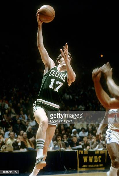 John Havlicek of the Boston Celtics shoots a hookshot against the Washington Bullets circa 1973 during an NBA basketball game at the Capital Centre...