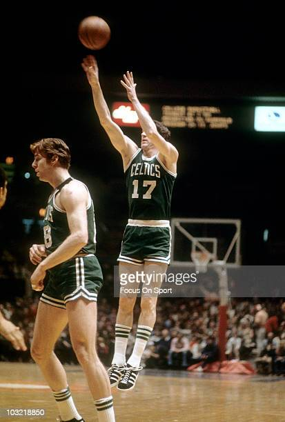 John Havlicek of the Boston Celtics shoots a jumpshot against the Washington Bullets circa 1976 during an NBA basketball game at the Capital Centre...
