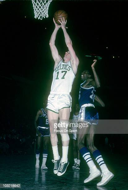 John Havlicek of the Boston Celtics shoots in front of Leroy Ellis of the Los Angeles Lakers circa 1965 during an NBA basketball game at the Boston...
