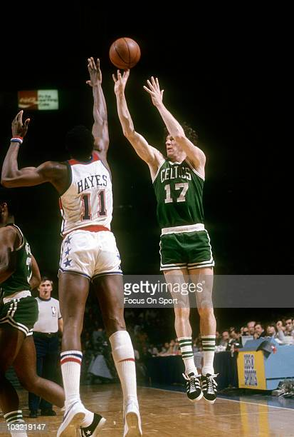 John Havlicek of the Boston Celtics shoots over the out stretched arms of center forward Elvin Hayes of the Capital Bullets circa 1973 during an NBA...
