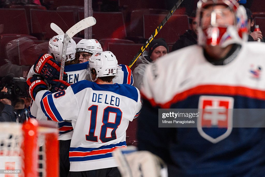 John Hayden #15 of Team United States celebrates his goal with teammates during the 2015 IIHF World Junior Hockey Championship game against Team Slovakia at the Bell Centre on December 29, 2014 in Montreal, Quebec, Canada. Team United States defeated Team Slovakia 3-0.