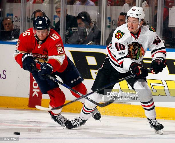 John Hayden of the Chicago Blackhawks crosses sticks with Aleksander Barkov of the Florida Panthers at the BBT Center on March 25 2017 in Sunrise...