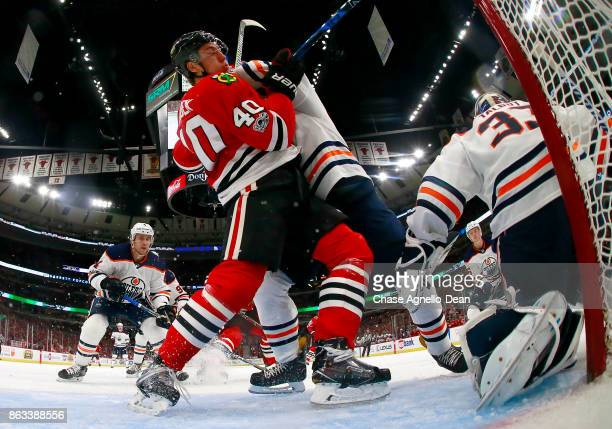 John Hayden of the Chicago Blackhawks gets physical with the Edmonton Oilers at the United Center on October 19 2017 in Chicago Illinois The Edmonton...