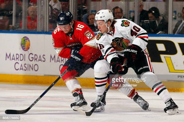 John Hayden of the Chicago Blackhawks skates for possession against Aleksander Barkov of the Florida Panthers at the BBT Center on March 25 2017 in...