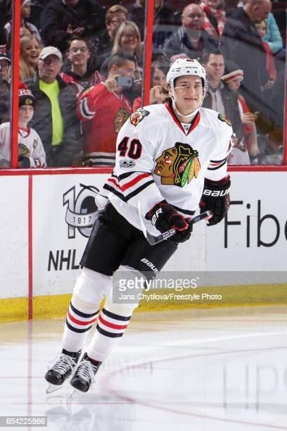 John Hayden the Chicago Blackhawks skates during the warmup before the rest of the team as he makes his NHL debut at Canadian Tire Centre against the...
