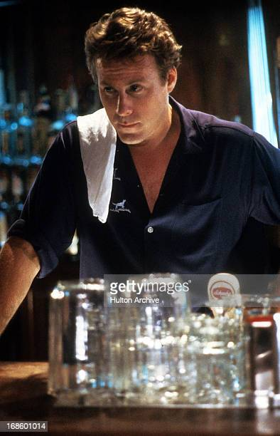 John Heard bar tending in a scene from the film 'After Hours' 1985