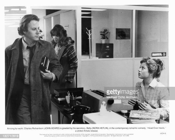 John Heard is greeted by Nora Heflin at work in a scene from the film 'Head Over Heels' 1979
