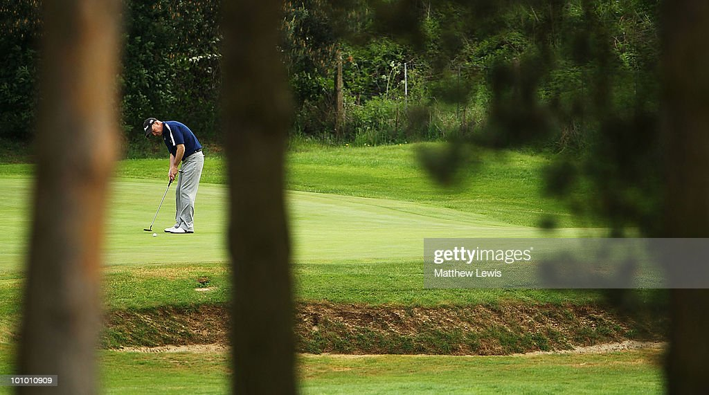 John Heggarty of Royal Liverpool makes a putt on the 8th hole during the second round of the Senior PGA Professional Championship at Northamptonshire County Golf Club on May 27, 2010 in Northampton, England.