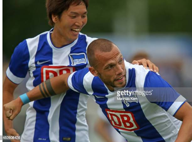 John Heitinga of Berlin jubilates with team mate Genki Haraguchi after scoring the first goal during the pre season friendly match between Hertha BSC...