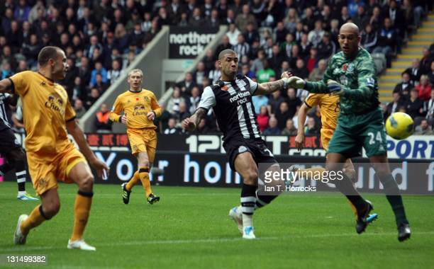 John Heitinga of Everton scores an own goal past teammate Tim Howard during the Barclays Premier League match between Newcastle United and Everton at...