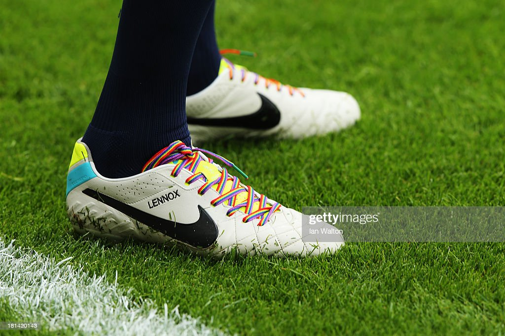 John Heitinga of Everton wears rainbow-coloured shoe laces as part of a campaign against homophobia in football before the Barclays Premier League match between West Ham United and Everton at the Boleyn Ground on September 21, 2013 in London, England.
